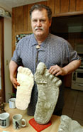 (NNS3-JAN9) Ray Crowe compares a Bigfoot cast print (l) that he considers authentic with one faked by Ray Wallace in the woodlands of Humboldt County, Calif. SEE ``BIGFOOT-DIEHARDS'' (Newhouse), transmitted Jan. 9. (Photo by Doug Beghtel)